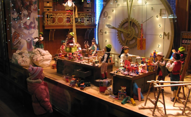 The desert Book Flagship store has a Christmas window display based on the gingerbread cookie factory scene.