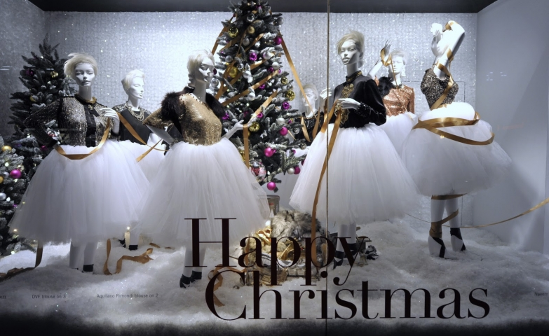 This time, Holt Renfrew has a Christmas window display with women mannequins, dressed with white tulle skirt, staying near adorned firs.