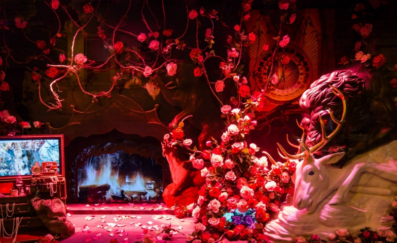 Maybe Lafayette wanted to show through their window display, that we know for sure it's winter, when the Christmas is coming and nature is killed, like the lion is killing the deer, with a subtle red light.