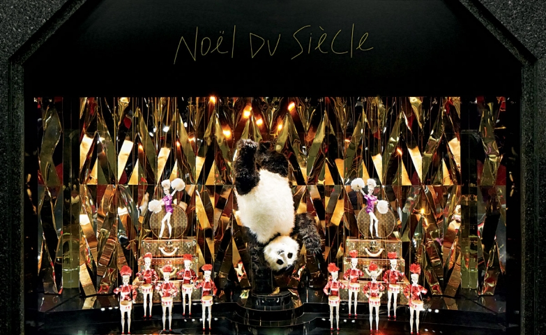 """Louis Vuitton has a theme called """"Noel du Siecle"""" which is represented by gold mirrors, and puppets having a show in the Christmas window display."""