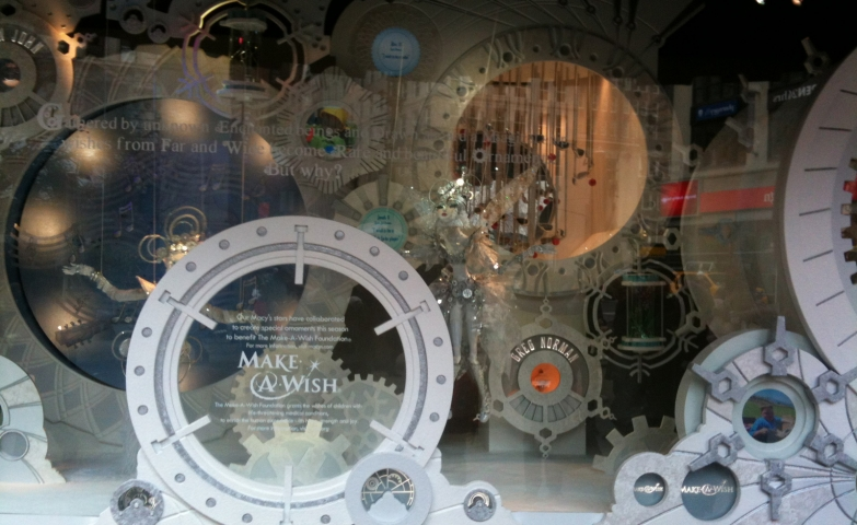 """Using a white and clean color scheme, Macy's has a spectacular """"Make a Wish"""" mechanism for the Christmas window display."""
