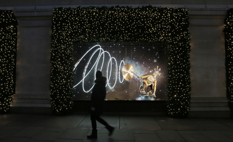 One of the themes from Selfridge's Christmas window display was the zodiac theme, with a sign spreading a blue light.