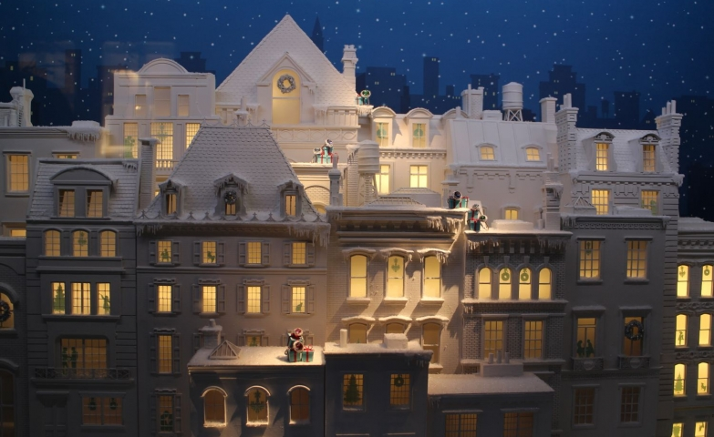 Tiffany's Christmas display is designed with a big illuminated white palace layout and a few presents.